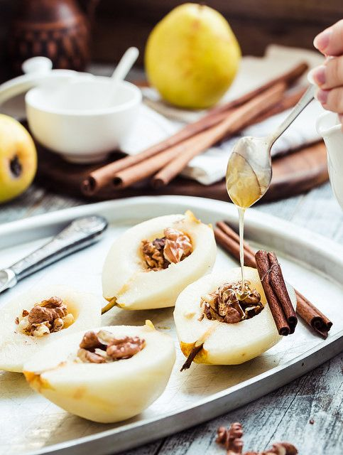 spicy baked pear with walnuts, honey, cinnamon sticks, healthy dessert