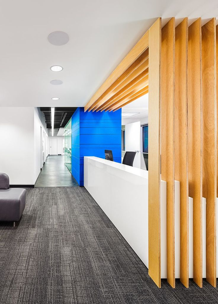 Integrated wood beams/headers at reception desk Owens+Orthodontics+-+Reception+to+Open+Bay