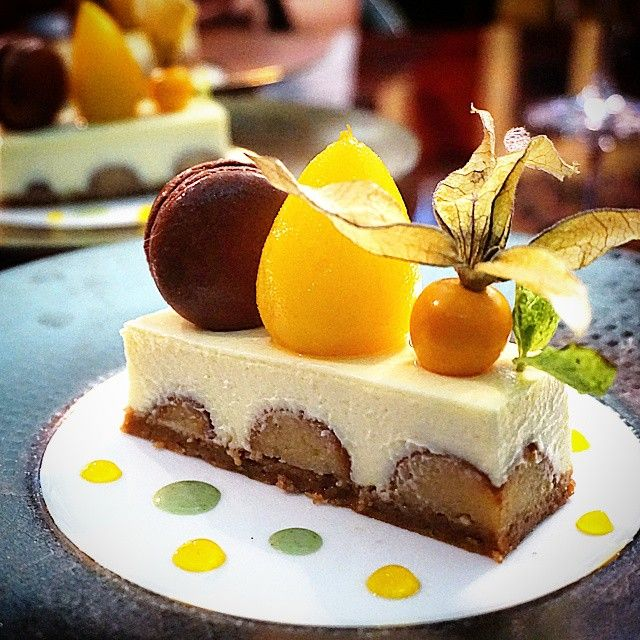 Gulab jamun cheesecake with saffron-poached pear and chocolate macaron.