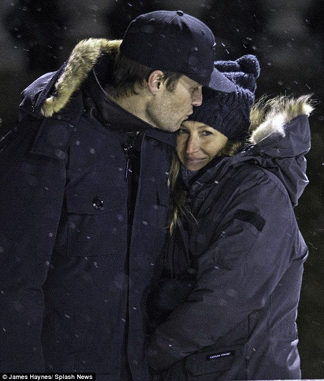 Cuddly: Tom Brady was seen planting a tender kiss on wife Gisele Bundchen's forehead as they took in their son Benjamin's hockey practice in Boston on Monday