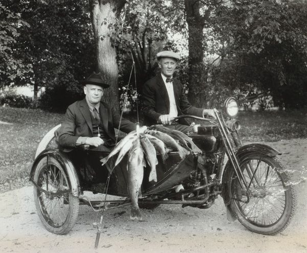 William A. Davidson (in sidecar) and William S. Harley show their catch made on Pine Lake in 1924.