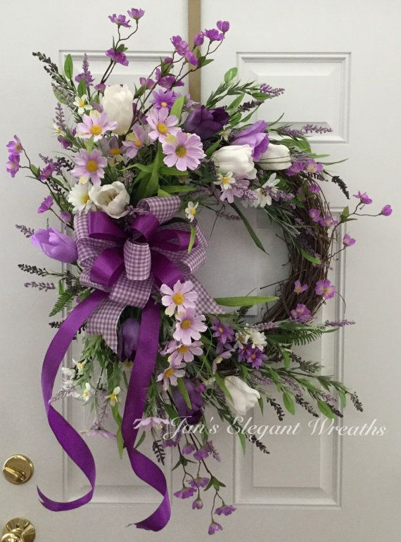 A Breath of Spring time in Purple! A basket of smiles! Purple daisies, white daisies, purple and white tulips, cherry blossoms, and lots of