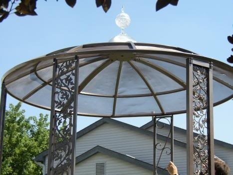 Gazebo from a large satellite dish. . . growing some grapes on this. . .too cool!