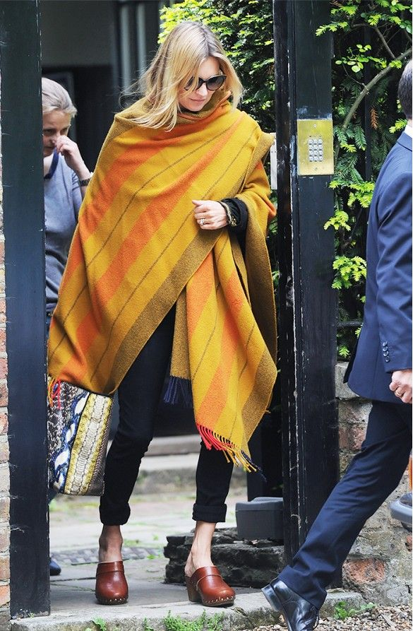 Kate Moss wrapped up in a yellow blanket cape // #Streetstyle