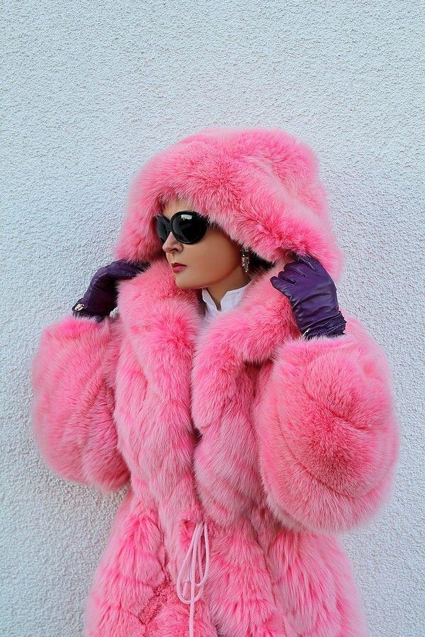 Pink fox fur parka. Like Barbie crossed with Cruella Deville.