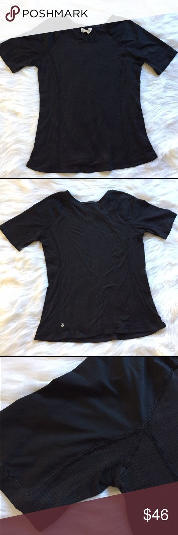 "Lululemon Athletica Black Striped Short Sleeve Top •lululemon athletica Black Short Sleeve Top •Women's Size 10 •Faint metallic stripes •lululemon logo on back lower left •slight scoop neck  •All measurements are approximate: 25"" length, 18"" armpit to armpit, 4.5"" armpit to end of sleeve •Body: 92% nylon, 5% x-static silver nylon, 3% spandex // contrast 1: 87% nylon, 13% lycra // contrast 2: 86% recycled polyester, 14% spandex lululemon athletica Tops Tees - Short Sleeve"