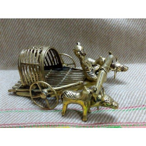 The Exclusive Dokra schulpture in shape of Bullock cart is hand crafted and is unique and trendy with ethnic and traditional look.  Material: Dokra.  Dimension: 4inches X 7 inches.   Weight: 500grams.  Color:copperish golden.   Dokra is tribal art of India mostly practiced in West Bengal and Orissa. In this art form, the mold is used only once and the metal used is usually brass. Each dokra artifact is unique in the world.