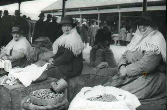 Women selling cockles at Carmarthen Market, c. 1930
