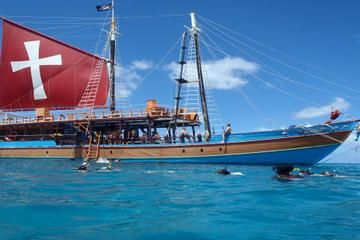 Lunch and Snorkel Sail in Barbados. Hop aboard the 'Jolly Roger' schooner for 4 hours of fun, including rope swinging, plank walking and conga dancing with fellow partygoers.
