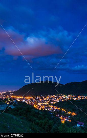 Brasov downtown twilight view and Tampa montain, local landmark. Medieval city in Transylvania, Romania.