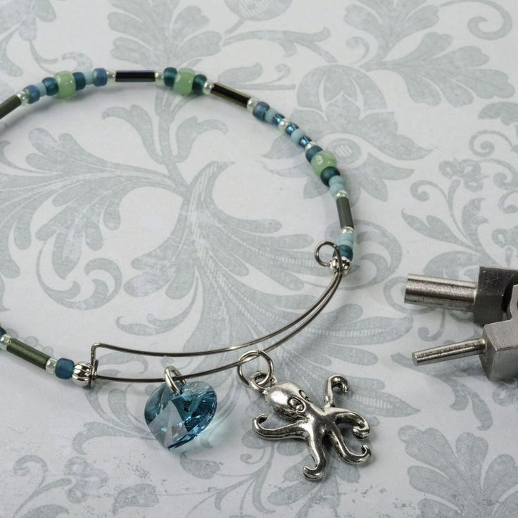 How to make an expandable bangle bracelet with charms.