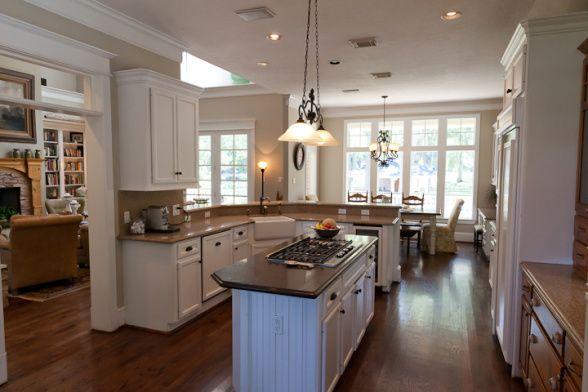 urban farmhouse white kitchen with dark floors