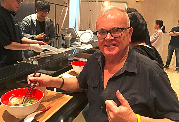 Travel blogger sampling noodles at newly opened Japanese ramen shop in Hong Kong.