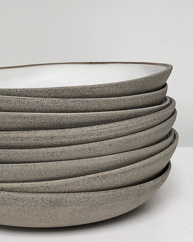 Urban casual. The equivalent of 'jeans and t-shirt' of tableware.  . .  20cm handbuilt pasta bowls from the Bespoke Grey series in White. Microwave and dishwasher safe. Discover the range online (link in bio). . . . . . . #pottery #ceramics #stoneware #potter #twinearthceramics #dinnerware #food #tabletop #cheflife  #foodblogger #restaurant #michelinstar #rustic #tableware #styling #textures #minimal #design #natural  #handbuilt  #handmade #propshop #platesforchefs  #chefsofinstagram #plate…