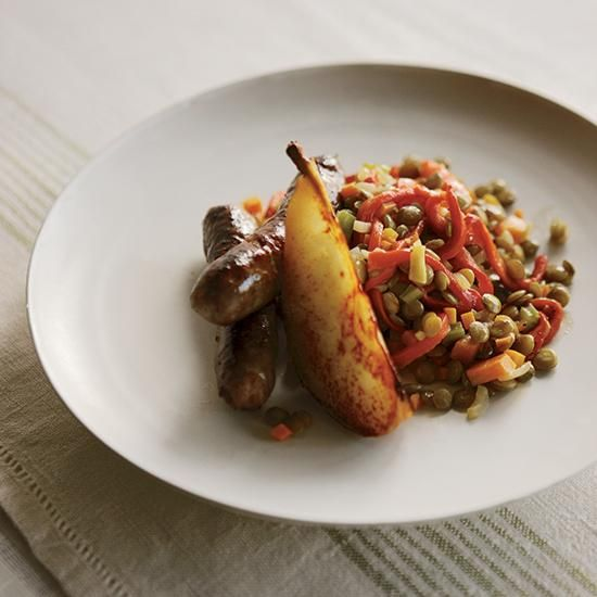 Lamb Sausage with Lentils and Sautéed Pears   One of Defne Koryürek's favorite homemade sausages includes beef, lamb, red peppers and garlic; she loves eating it alongside a creamy salad of lentils, roasted peppers and sautéed pears. The recipe is also delicious when prepared with spicy, rich merguez sausage.