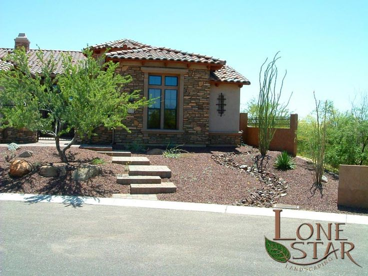 front yard xeriscape with river run and desert landscaping in
