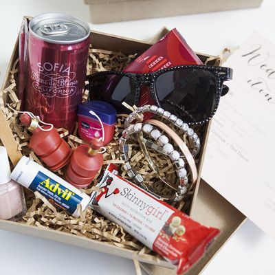 Make your besties a cute gift box full of inexpensive items to help them make it through your long and wonderful wedding day - the bridesmaid survival kit!
