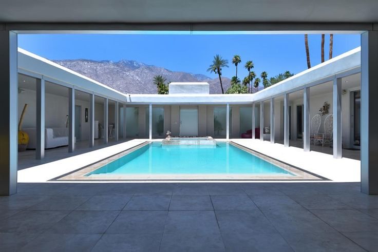 A stunning pool, spa and fire pit greet you as you enter this private midcentury modern compound.