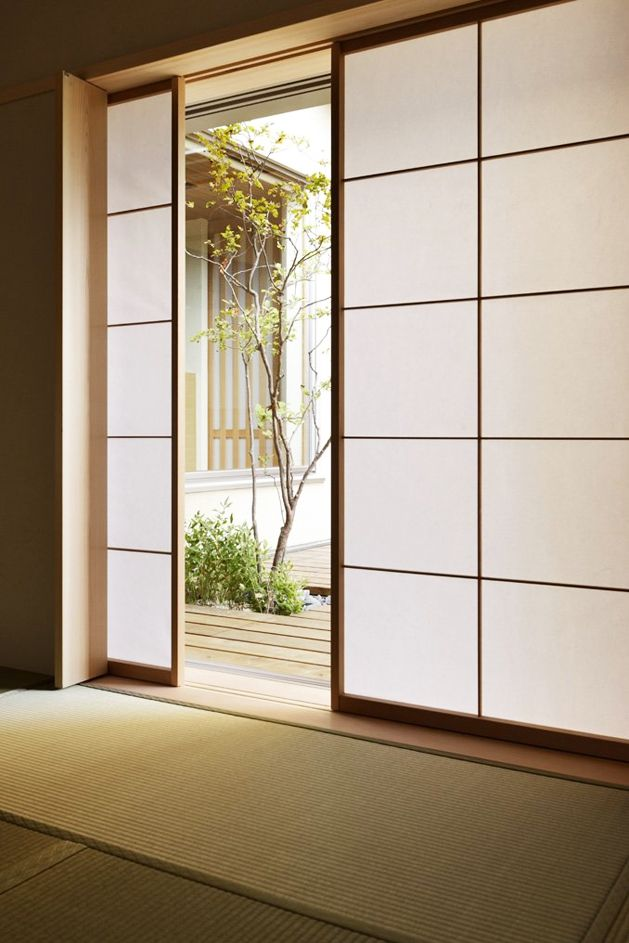japanese sliding door... great for a multi purpose guest house door from main space to bedroom space. So flexible and airy.