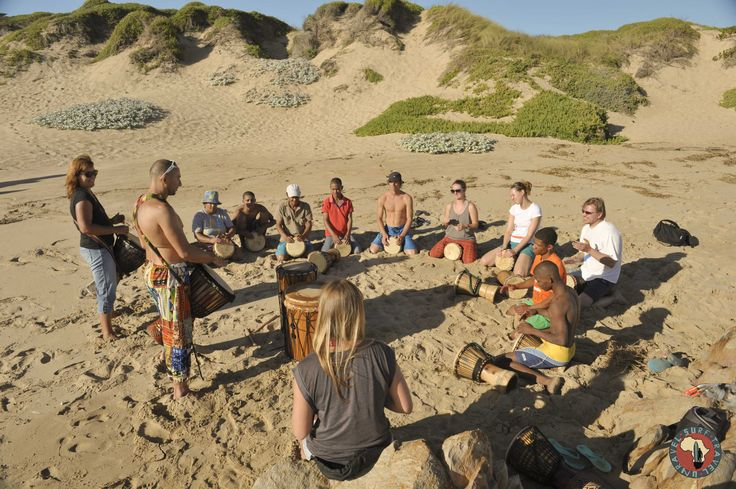 Drumming circles on the beach! One of many fun and exciting things happening on Surf Tour!