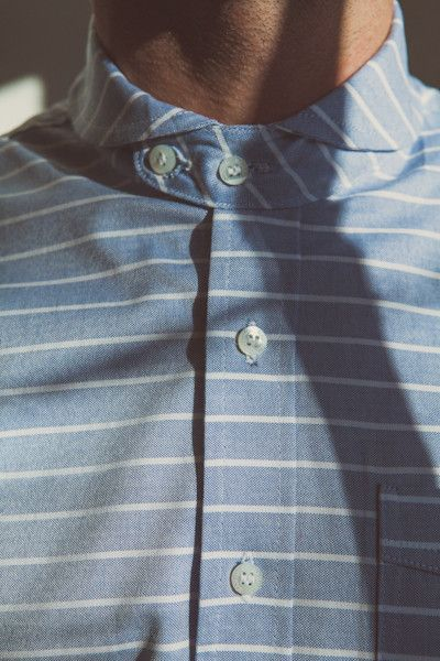 This is it! Button to the top to bring the outfit together.