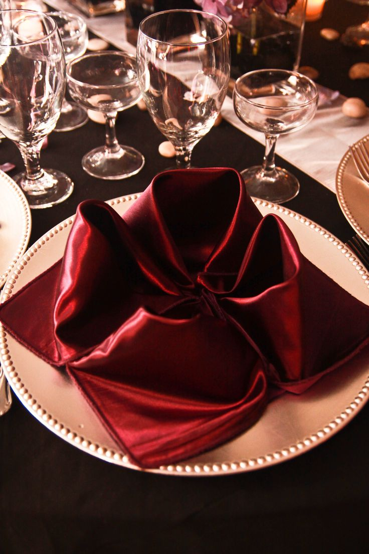 Marsala Satin Napkin In Flower Fold On Silver Charger With