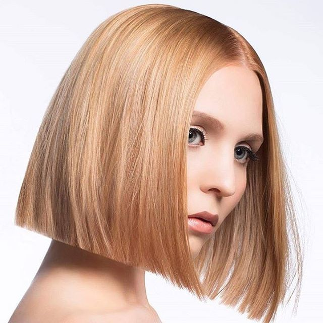 Absolutely gorgeous, don't know which we like better - the cut or color.... fabulous work by @knielsenhair To have your hair featured please tag #scruples #trueintegrity #cremecolor #strawberryblonde #haircolor #haircut #model  #geometry #hairpics #modernsalon #americansalon #hairbrained #sassoon #beauty #transformation #onelengthbob #classicbob #bobcut