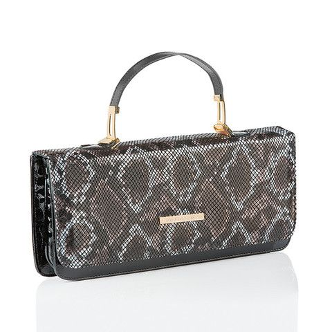 A classic East-West clutch bag in a leather snake print. Dress it up or down, it goes with anything! Check out more must have bags on www.vcdltd.com