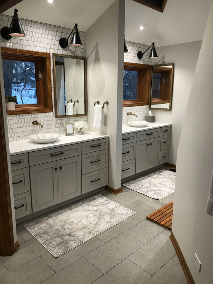 gray and white bathroom with teak wood trim and white