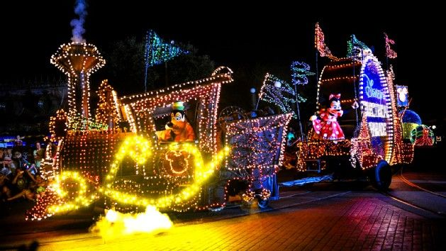 The Main Street Electrical Parade, a must see at WDW!  Contact me for a FREE QUOTE!  www.fairytalejourneysbymeredith.com