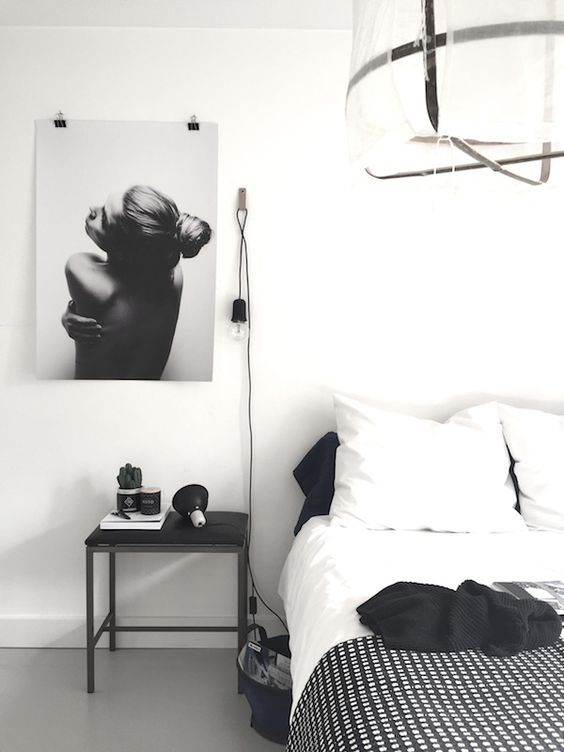 A white bedroom with Dixxius bedlinen | Backside by Via Martine, poster from…