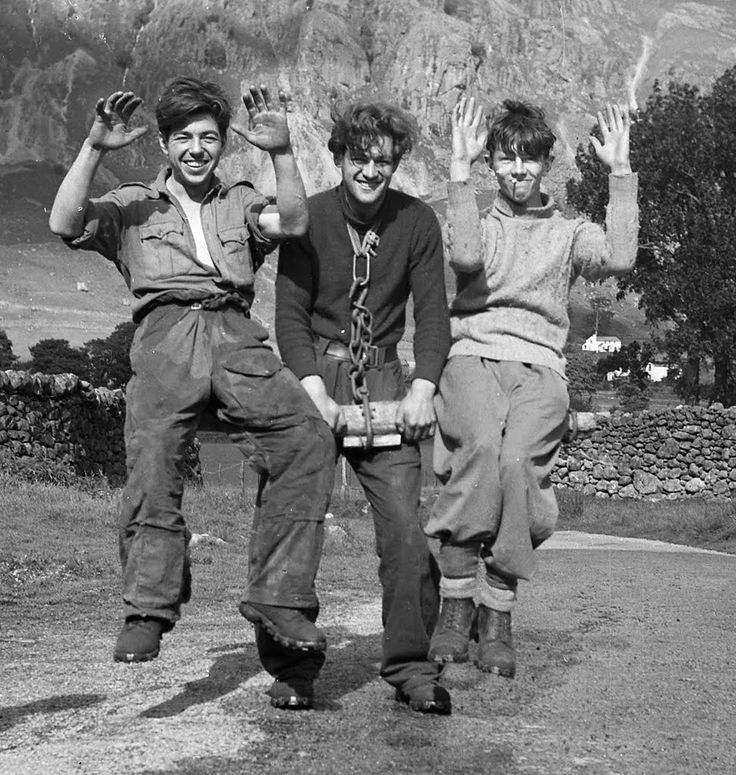 The Ox. Slim Sorrell gives his neck muscles a work out balancing Joe Brown and Pete Cargill. The Lake District, UK. 1951.