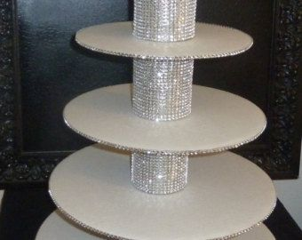 elegant tier bling wedding mini cupcake stand tower dessert display faux rhinestone round mirror cake pop candy bar buffet table centerpiece party shower decor  Simple and elegant, yet so sparkly! Can also be used to hold a cake on top in combination with mini cupcakes and/or cake pops. Lightweight sturdy base (dense foam). Several size options available in drop down box. Choose your size and style in the drop down box. As seen on a 2013 HGTV Celebrity Holiday Home episode!  Please note ...