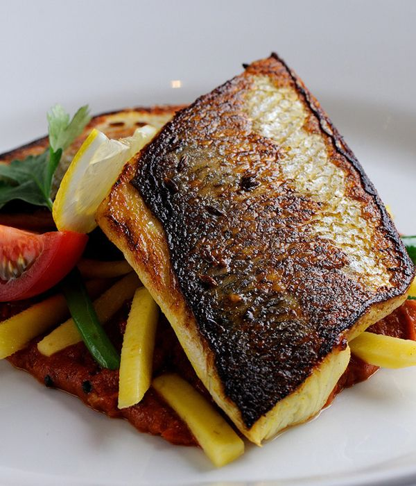 Alfred Prasad's flavourful sea bass recipe serves the pan-fried fish fillets with fine beans and raw mango.