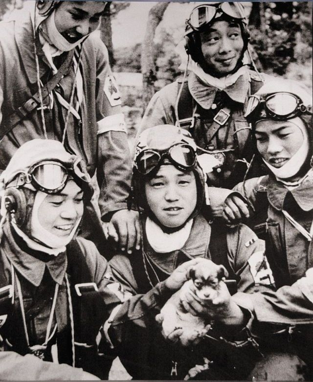 Corporal Araki Yukio holding a puppy, with four other pilots of the 72nd Shinbu Squadron around him, 26 May 1945. They were all Special Attack (kamikaze) pilots. The day after on 27 May 1945, Araki's Ki-51 bomber took off from Kagoshima, Japan, and never returned. He died at the age of 17.