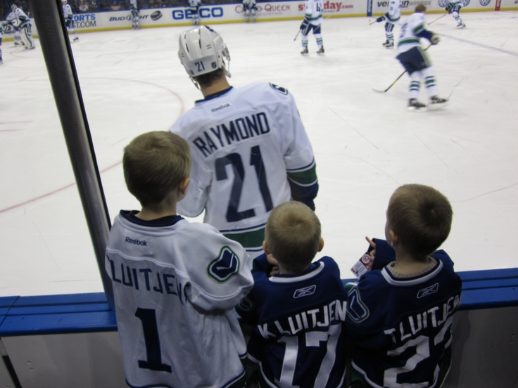 My kids at the Canucks game in St.Louis earlier this month. They're loving the warm-up and wearing their jerseys!