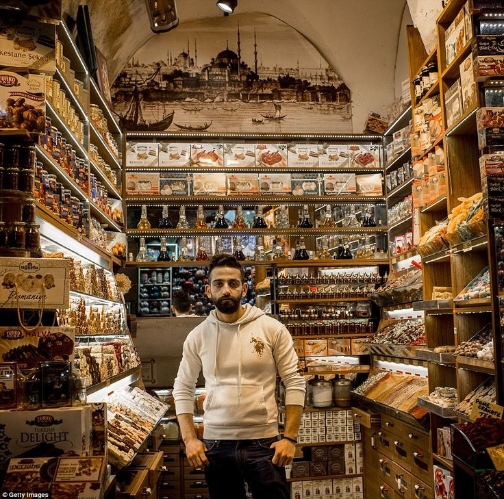 Hasan Ramo poses for a photograph at his store, selling traditional sweets and Turkish del...