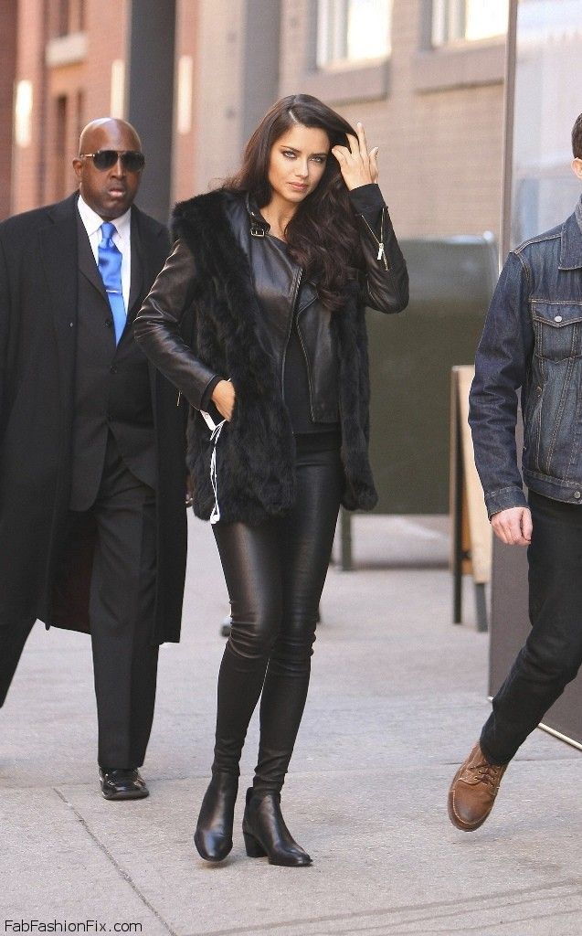 Adriana Lima street style with fur vest, leather jacket and pants (March 2016). #adrianalima