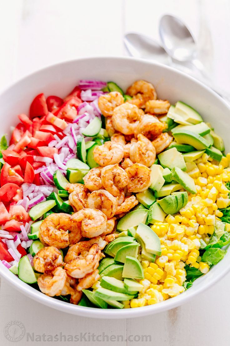 We could live off this shrimp avocado salad. This shrimp salad is crazy good and loaded with avocado, cucumbers, tomatoes & sweet corn. Light lemon dressing