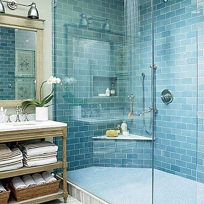 This Delaware bathroom incorporates neutral tones to channel the sandy expanses and cool, moody blues to echo the ocean.