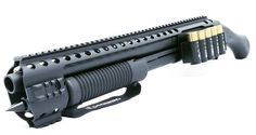 """Black Aces Tactical makes an upgrade kit for theMossberg 590 Shockwave shotgun … I mean """"firearm"""". It consists of a quad railwith a full-length top Picatinny rail and short frontrail sections on 3, 6 and 9 o'clock positions. The second part of this set is the side shell holder.It also comes with a magazine spike … Read More …"""