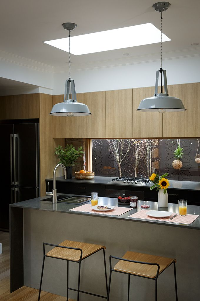 INDUSTRIAL: Strong matt black cabinetry is paired with timber elements to create a sense of warmth. The added textures of Caesarstone benchtops, transparent glass splashback and metal factory pendant lights ensured a tightly edited result. A perfect 10/10. Featuring:  •Cabinetry in Super Matt Black, Impressions Sublime Teak Riven & Newbury Basalt  •Caesarstone® benchtops in Piatra Grey with 20mm edge  •Built in Wine Rack and Butler's Pantry •Hettich InnoTech Drawer Systems
