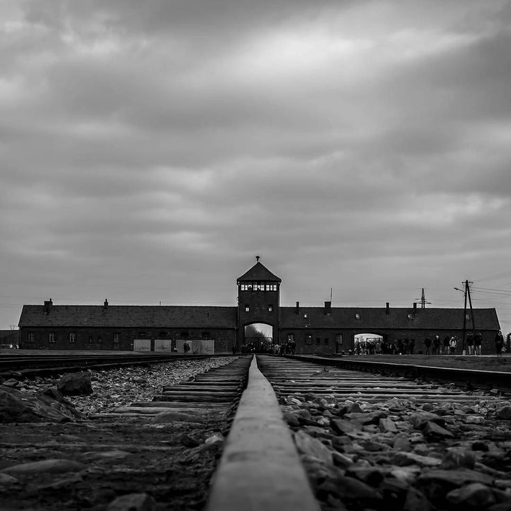--- Photo by @nathan_cafolla --- Auschwitz II-Birkenau. The main guard tower of the camp and the rails of the new unloading platform where selections of deported Jews took place from mid-May 1944.