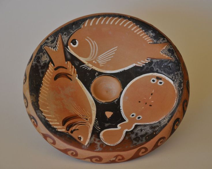 Apulian fish plate, 4th century B.C. Apulian fish plate, Apulian red figured fish plate, with three fish, a Diplodus vulgaris with black lines, a Torpedo torpedo and another, 18 cm diameter. Private collection
