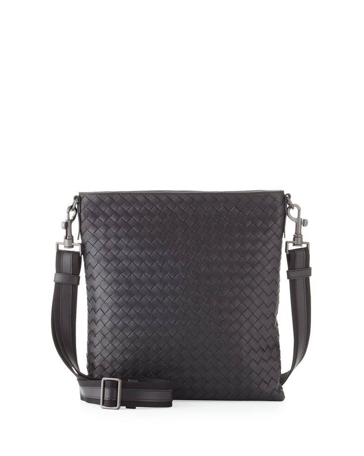 Men's messenger bag in Bottega Veneta signature intrecciato woven leather. Gunmetal colored hardware. Zip top. Adjustable, removable canvas crossbody/shoulder strap with 18in drop. Inside, canvas lining and open pocket. 11inH x 10inW x 2inD, bag weighs 1 lb. Made in Italy.