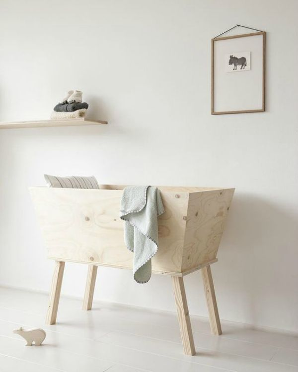 """""""Nanami is a new label for the little ones inspired by the beauty of nature"""". Love this wood bassinet!"""