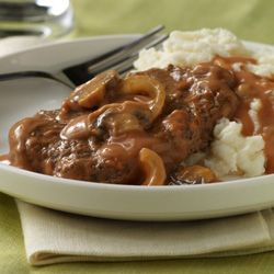 Easy Oven Baked Swiss Steak-Use the golden mushroom soup for a more beefy flavor.