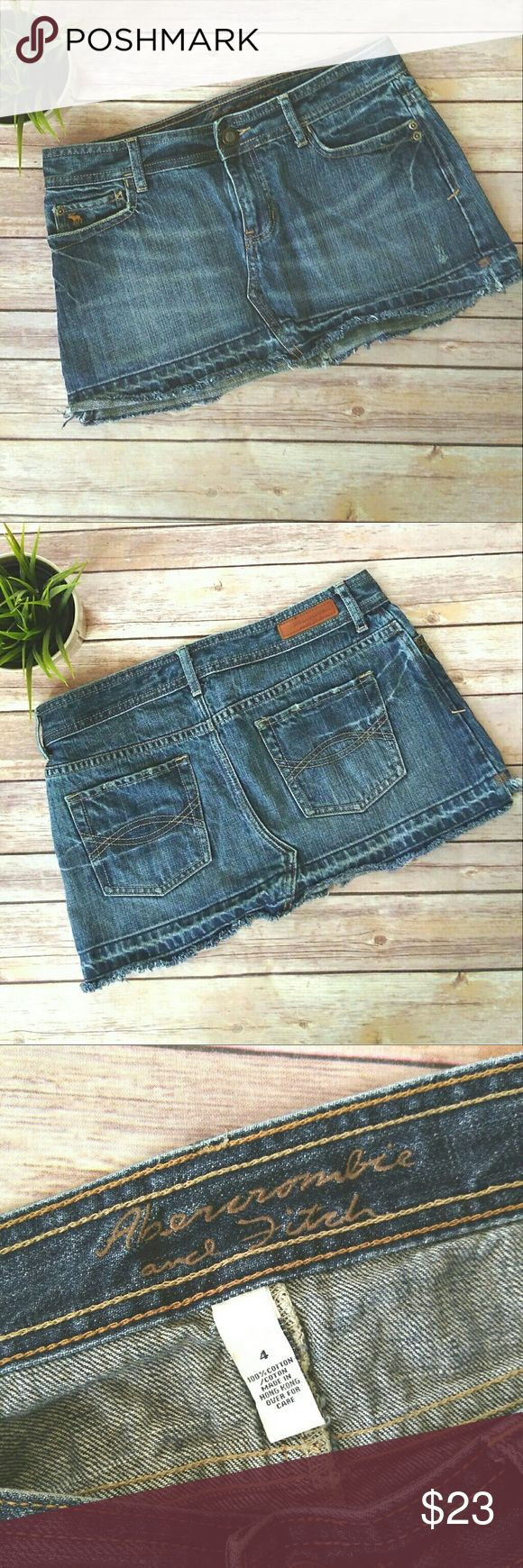 Abercrombie and Fitch denim mini skirt. Abercrombie and Fitch denim skirt.  It is a mini skirt in a  medium dark wash.  It has a distressed hem.  It is perfect for summer!  Looks great with everything!   Pet free smoke free home. Abercrombie & Fitch Skirts Mini