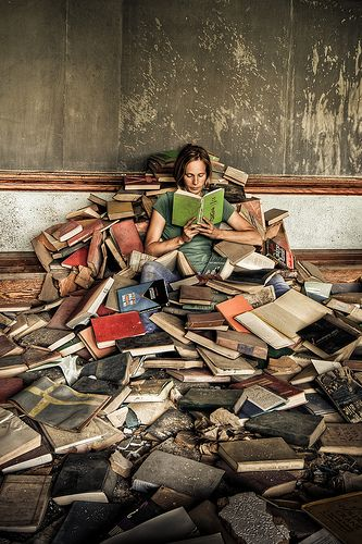 This is so me....working my way through the piles of wonderful books.
