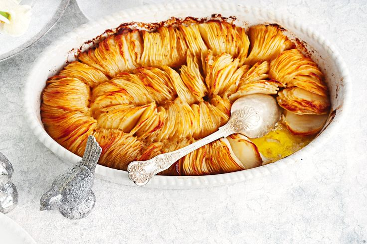 Drizzle+herb-infused+butter+and+oil+over+tightly+packed+rows+of+thinly+sliced+potato+for+a+crispier+version+of+classic+gratin.